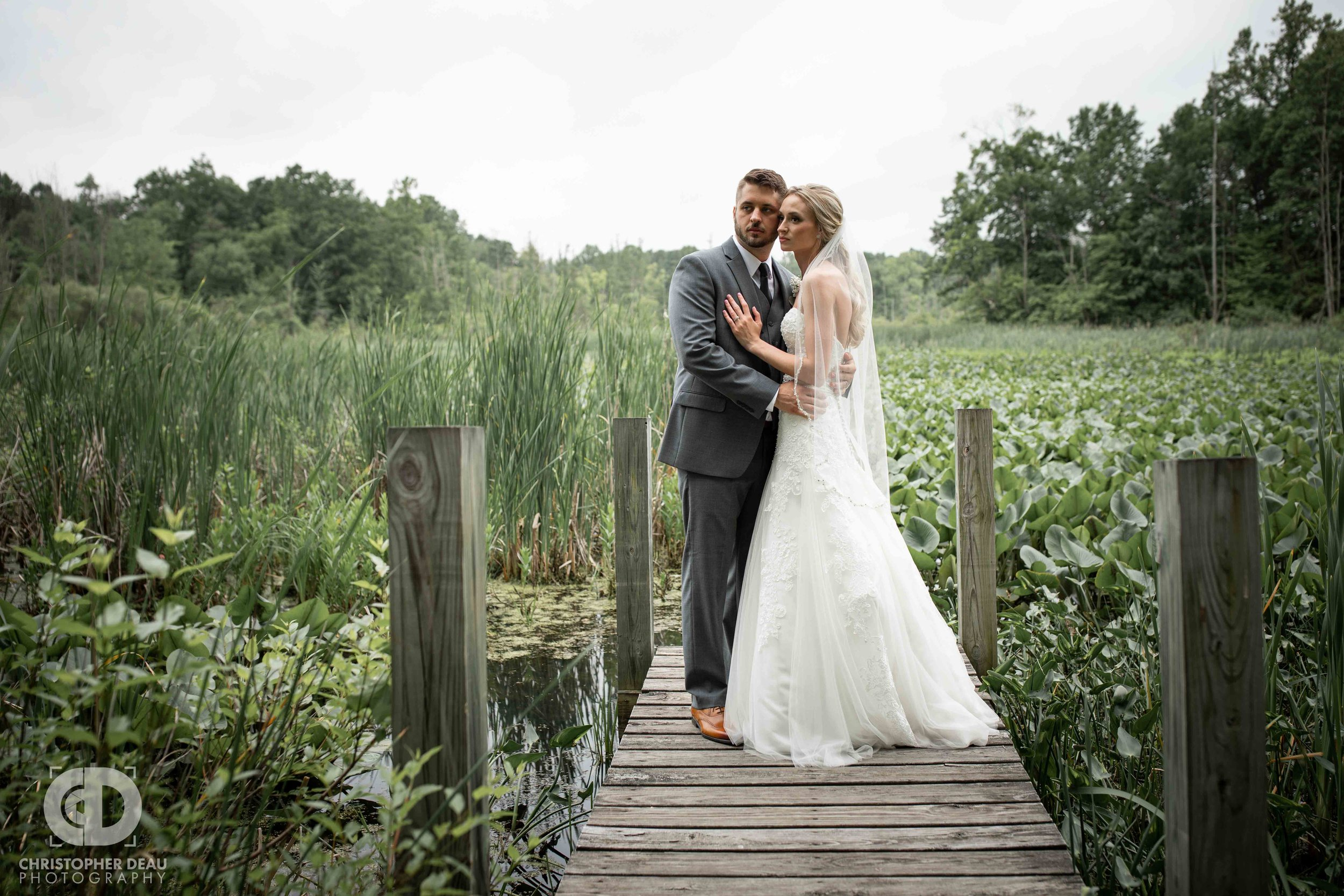 bride and groom at gable hill dock