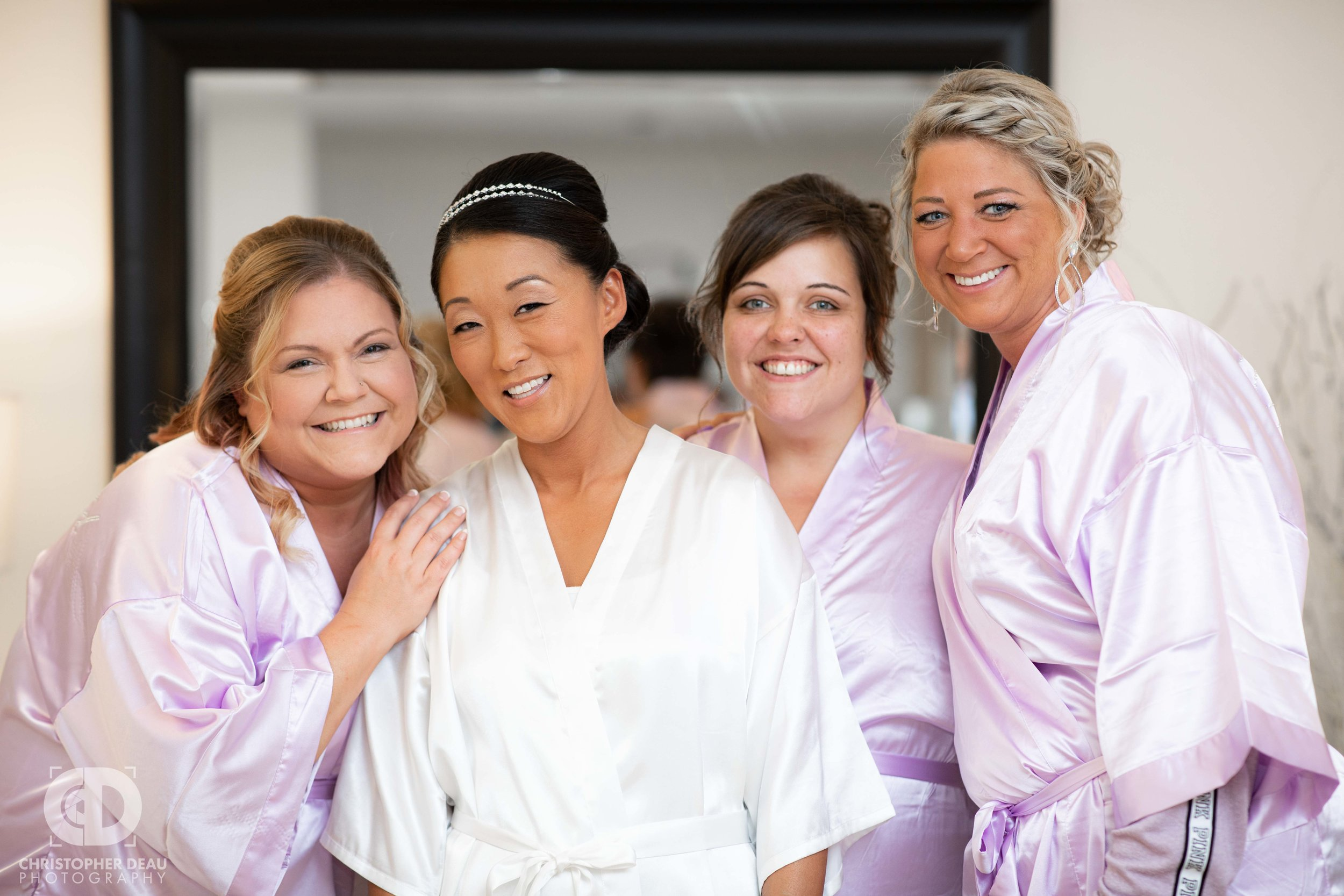 Bridesmaids with bride in their robes