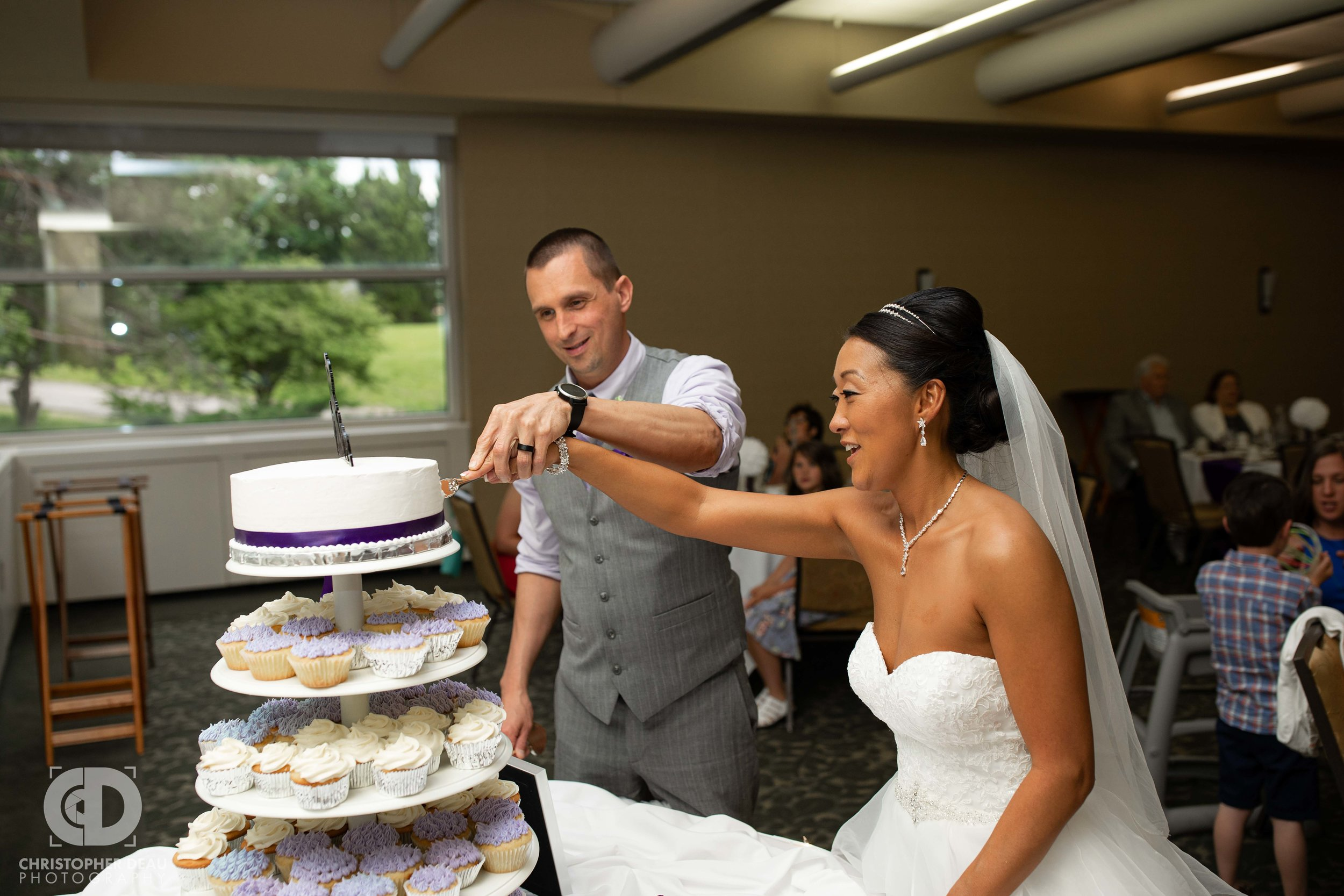 Wedding cake cutting at WMU Fetzer Center