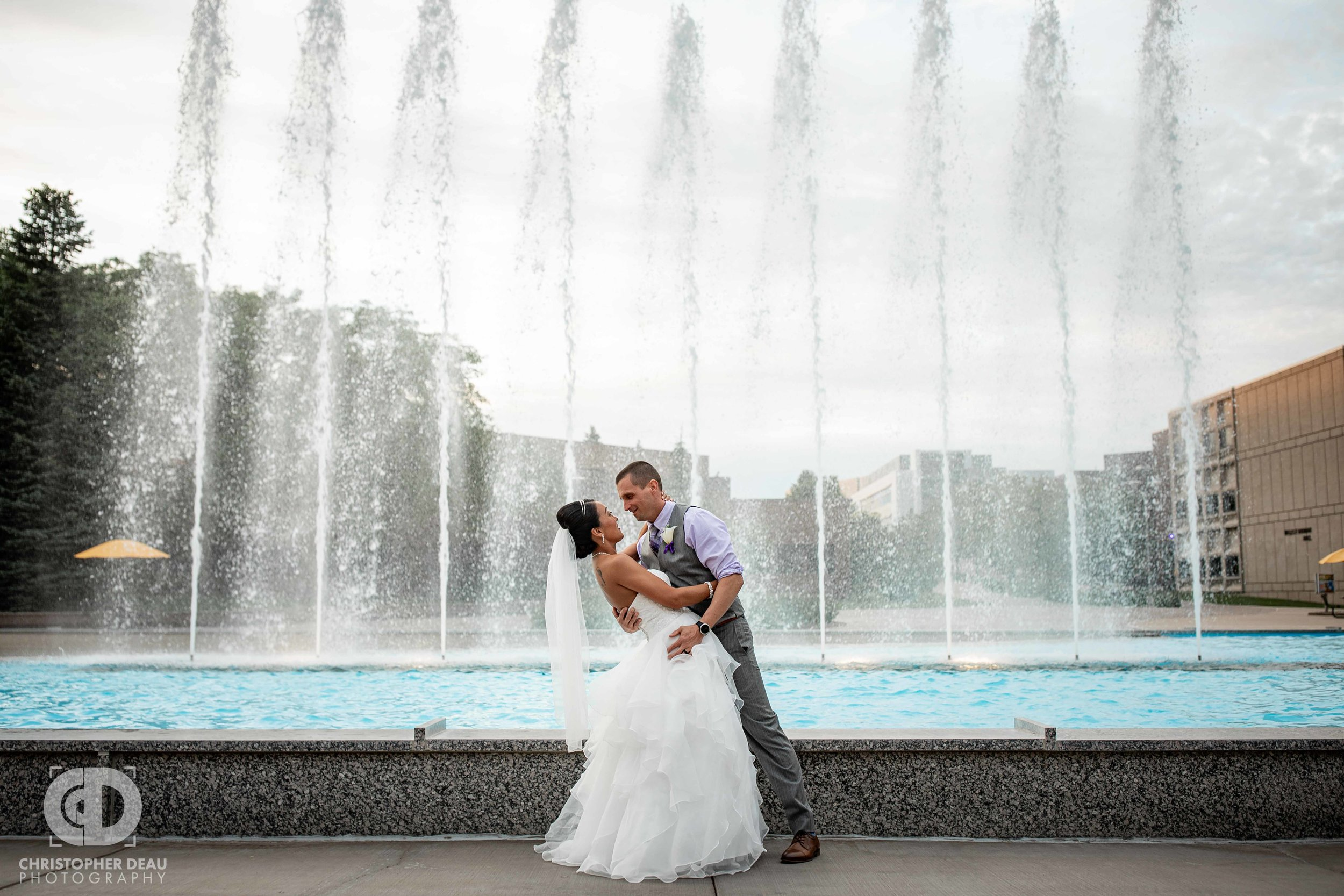 Bride and Groom in front of fountains at WMU Miller Auditorium
