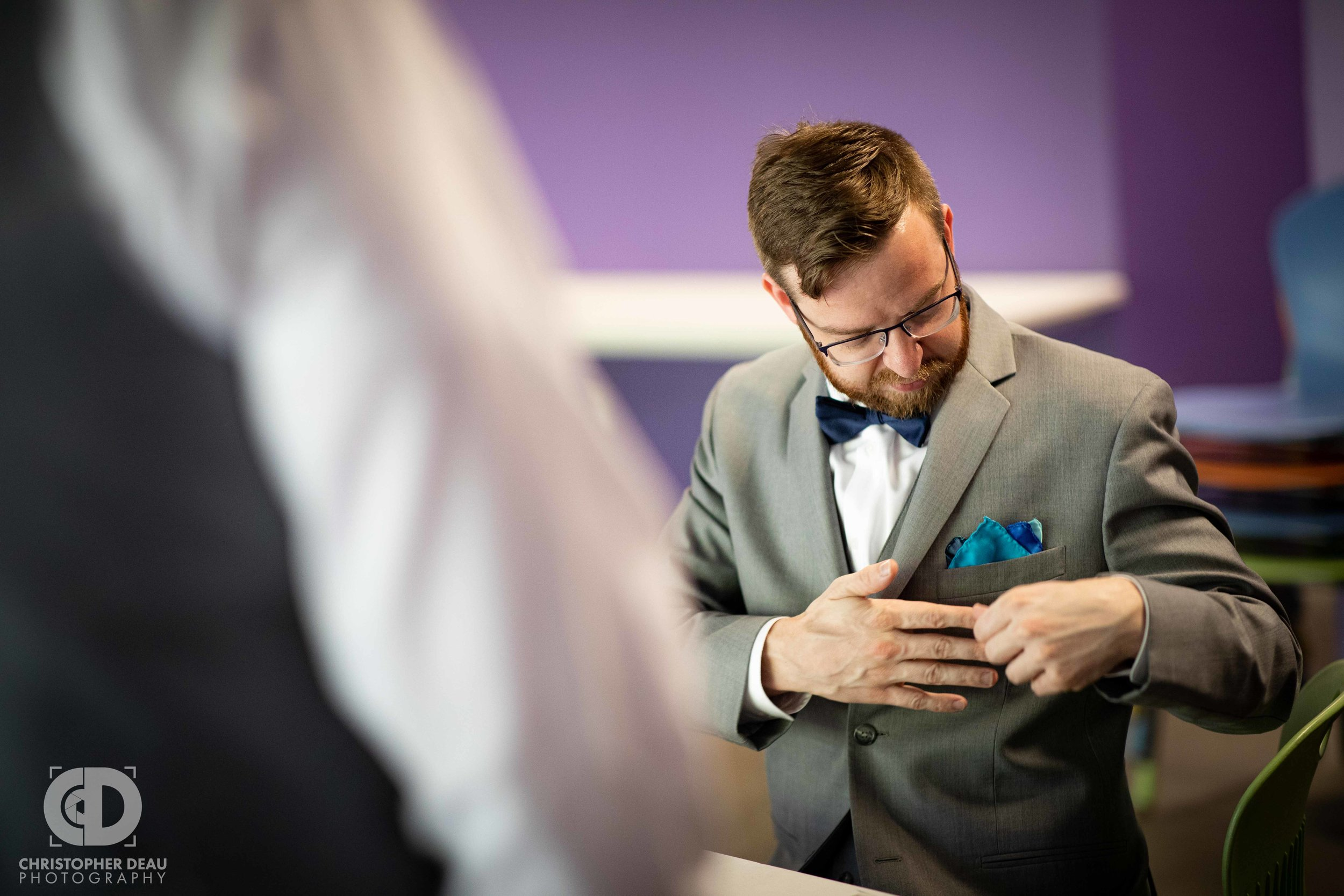 groom fitting his pocket square