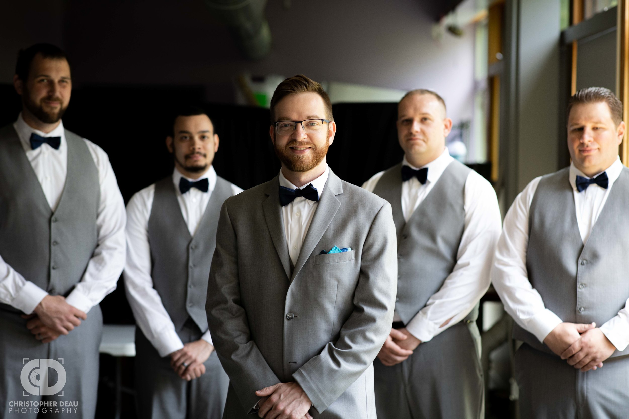 groom with his groomsmen in great lighting