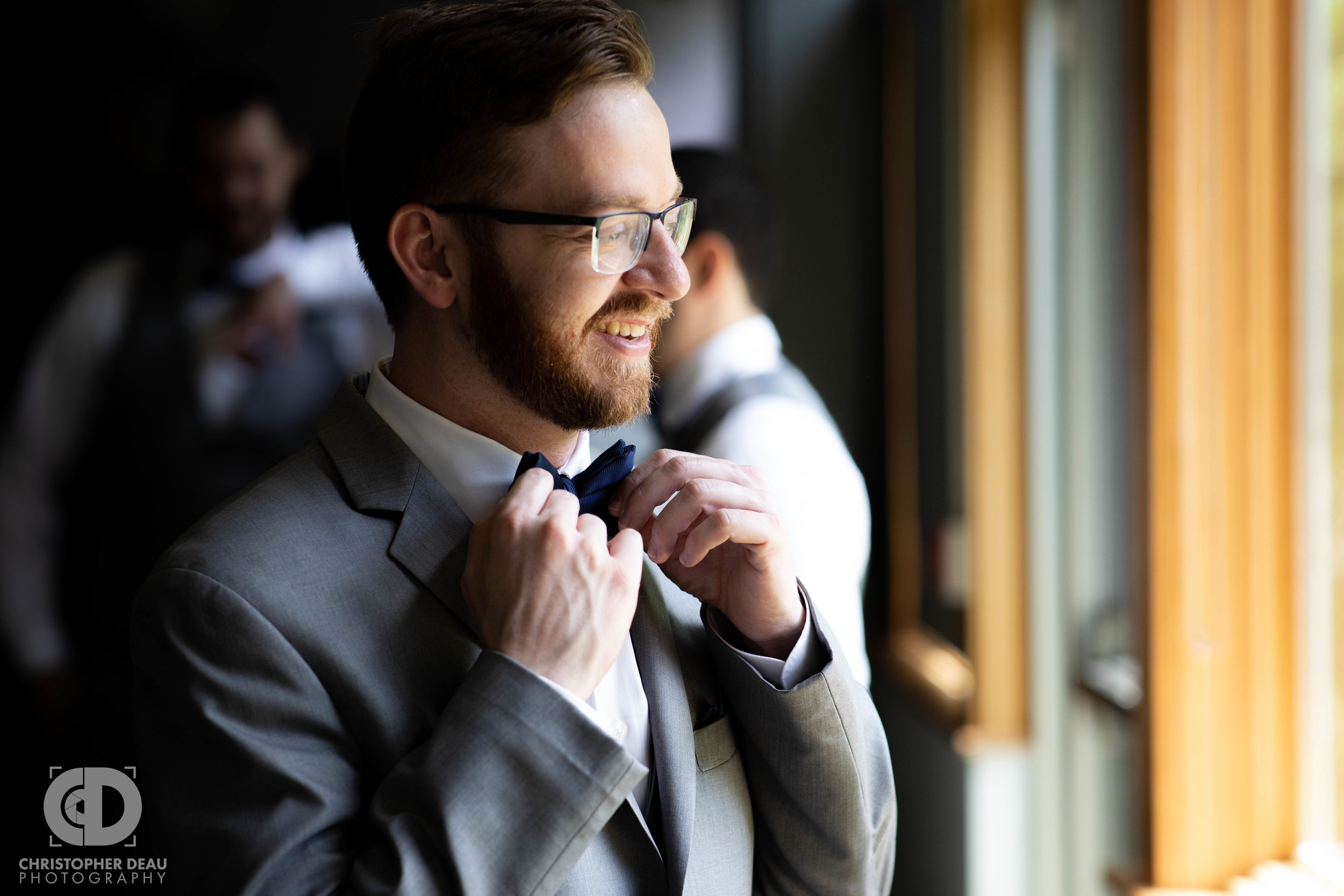 groom straitening bowtie