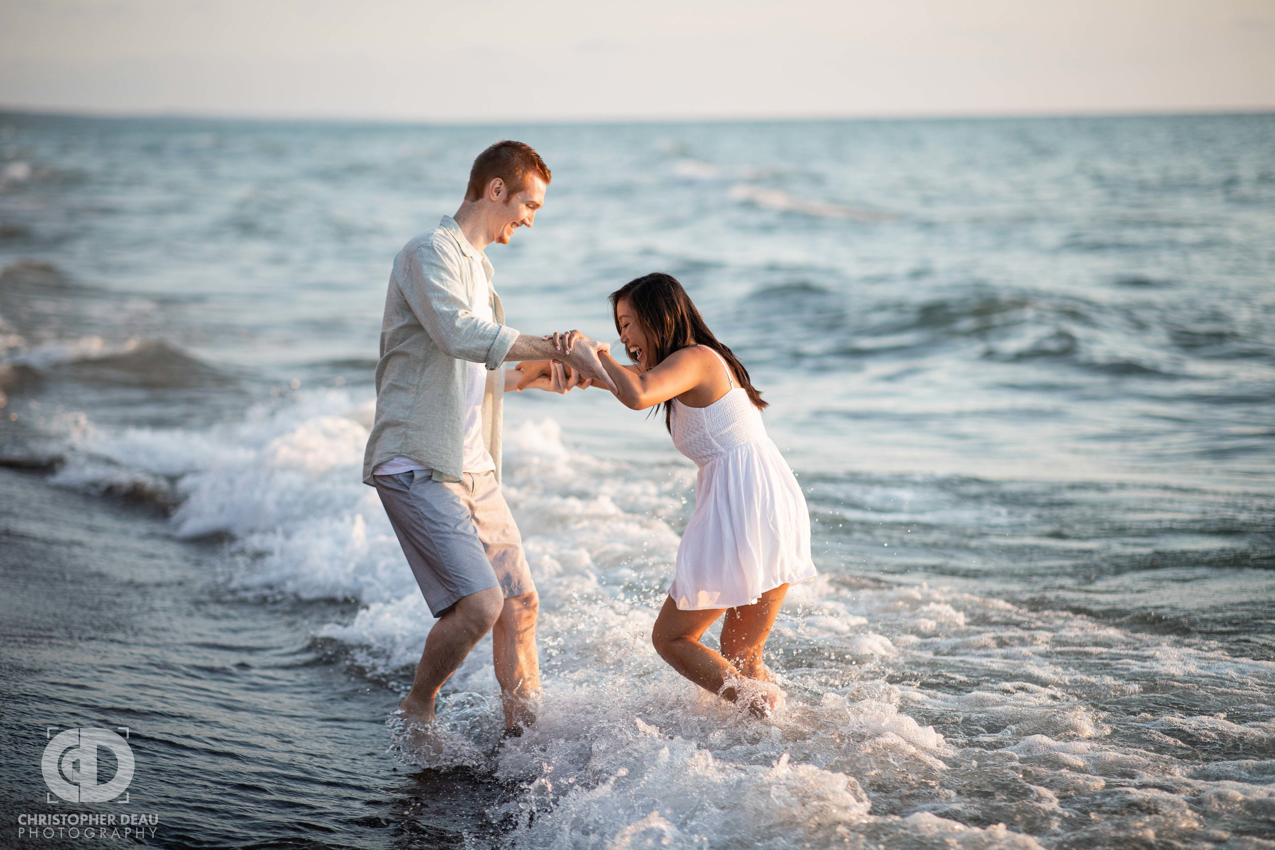 Engagement photo session in the water of Lake Michigan