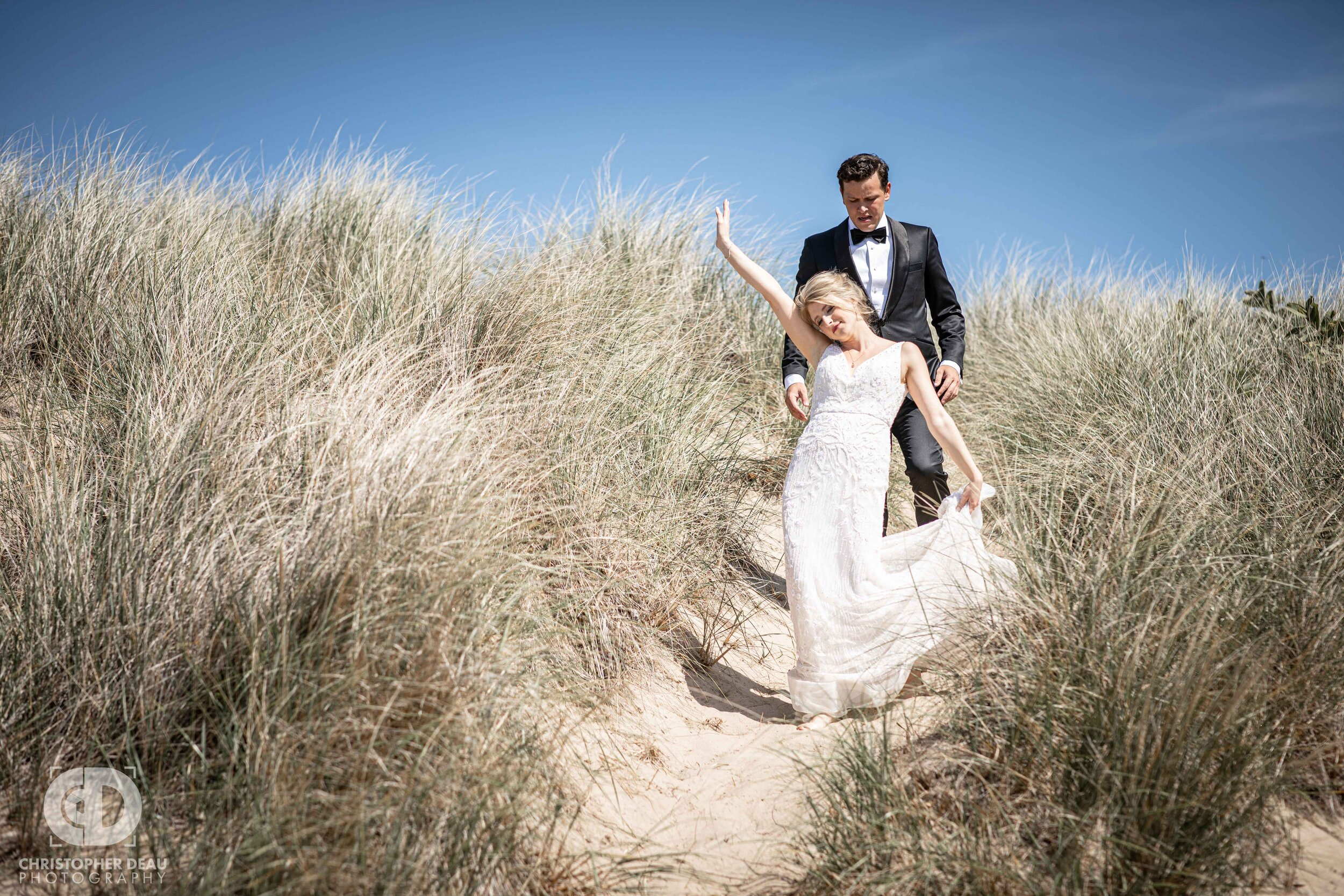 bride and groom descending a lake michigan sand dune