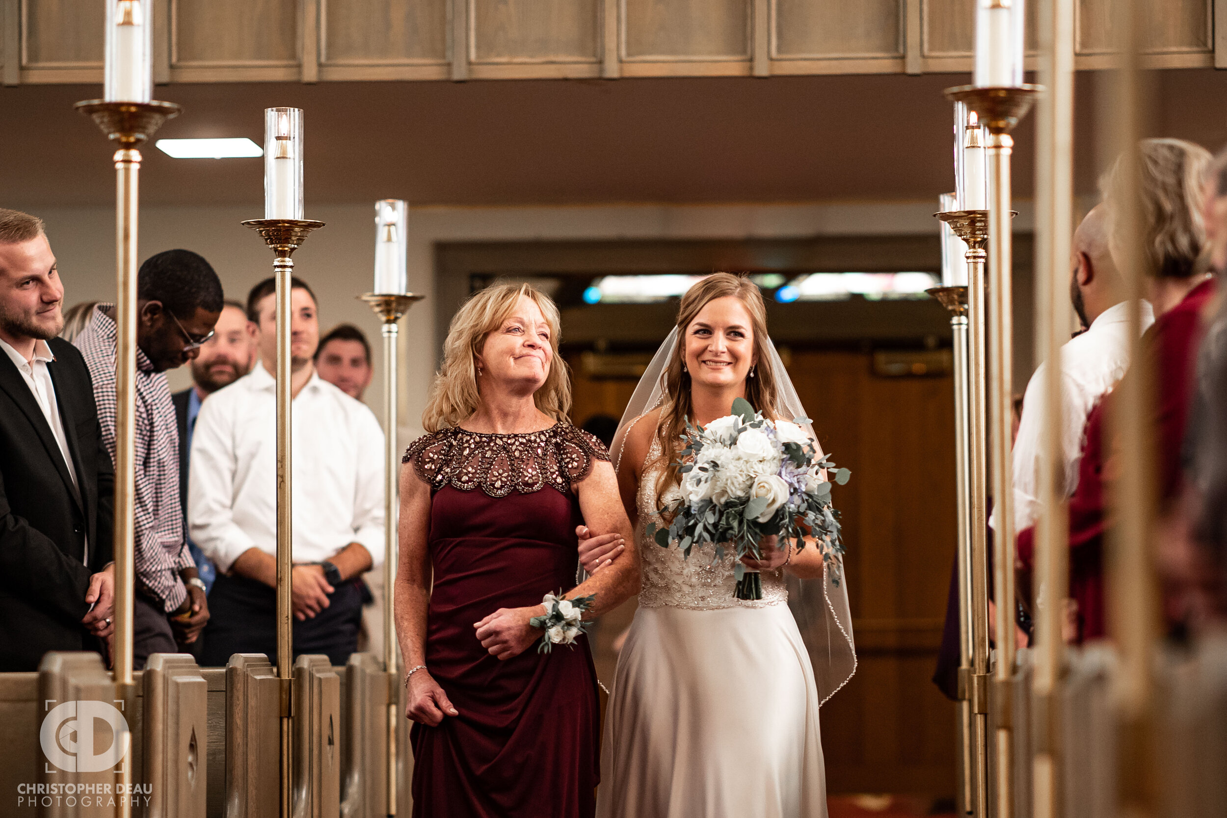 Mother and Bride walking down the aisle of Trinity Lutheran Church in Kalamazoo