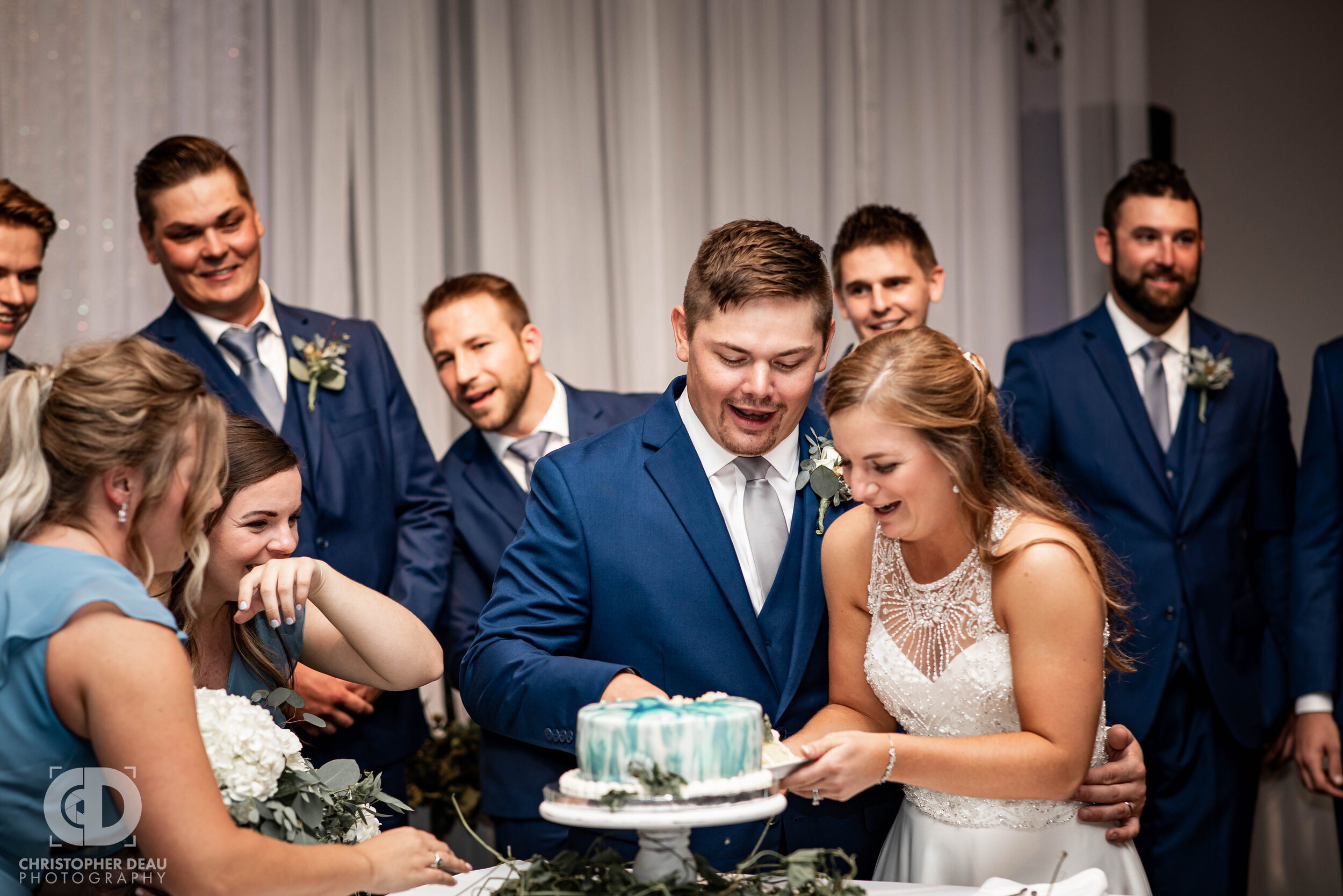 bride and groom cut their wedding cake at cityscape in kalamazoo michigan
