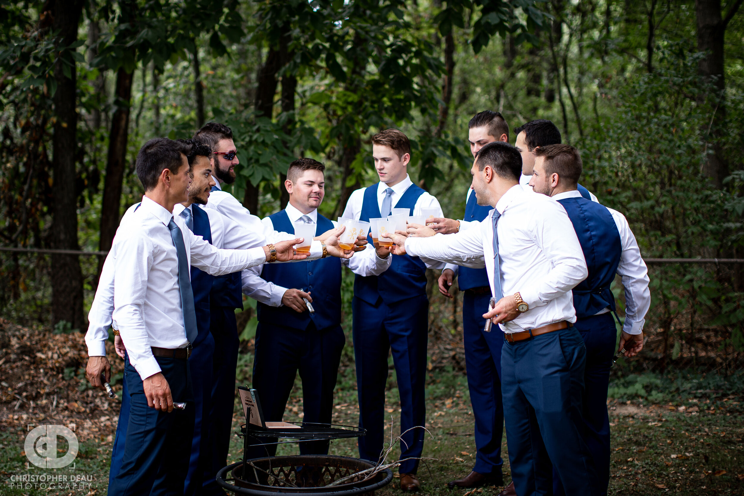 groomsmen enjoying a whiskey toast before the wedding