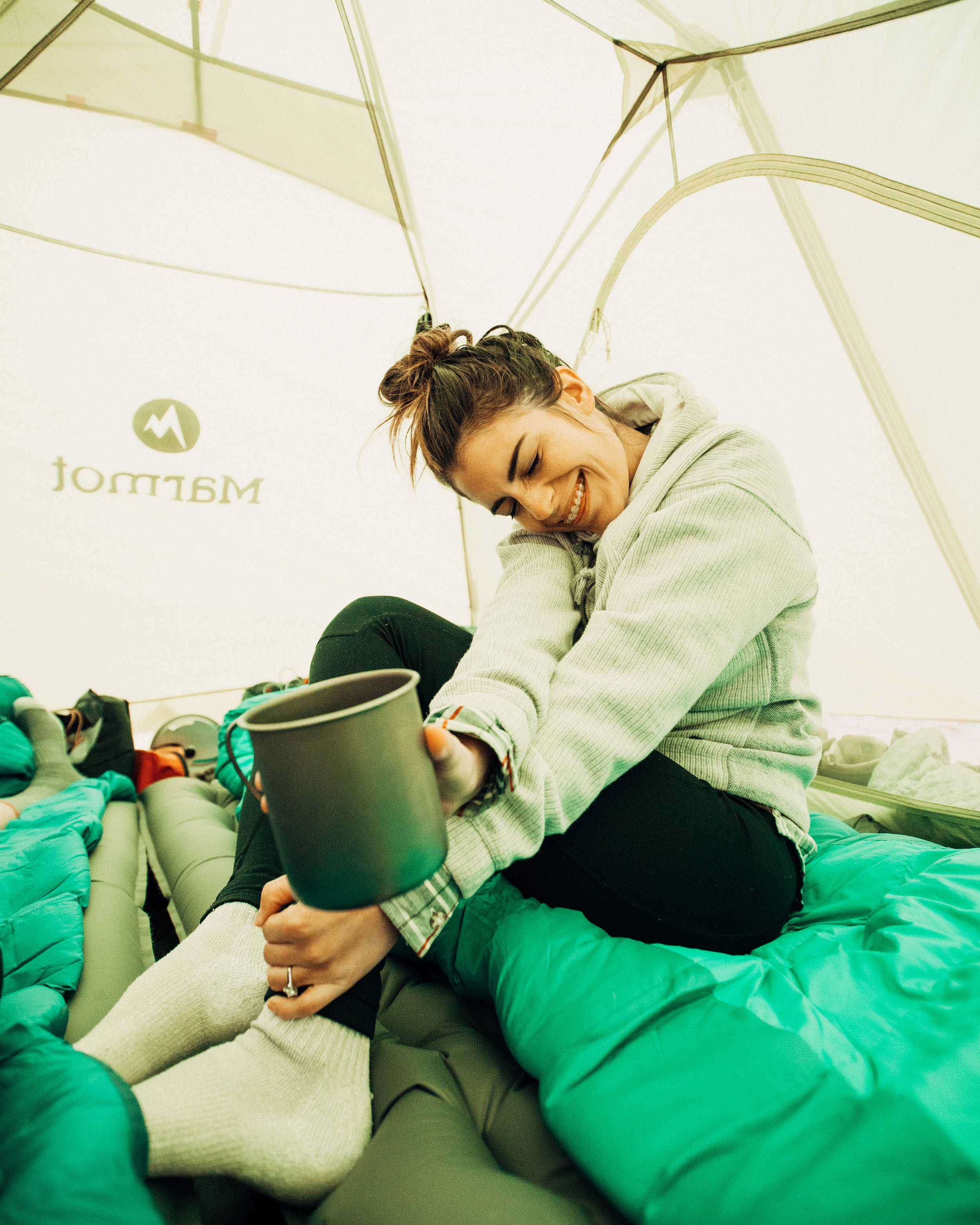 Avoiding the rain and enjoying a hot cup of coffee in our tent!
