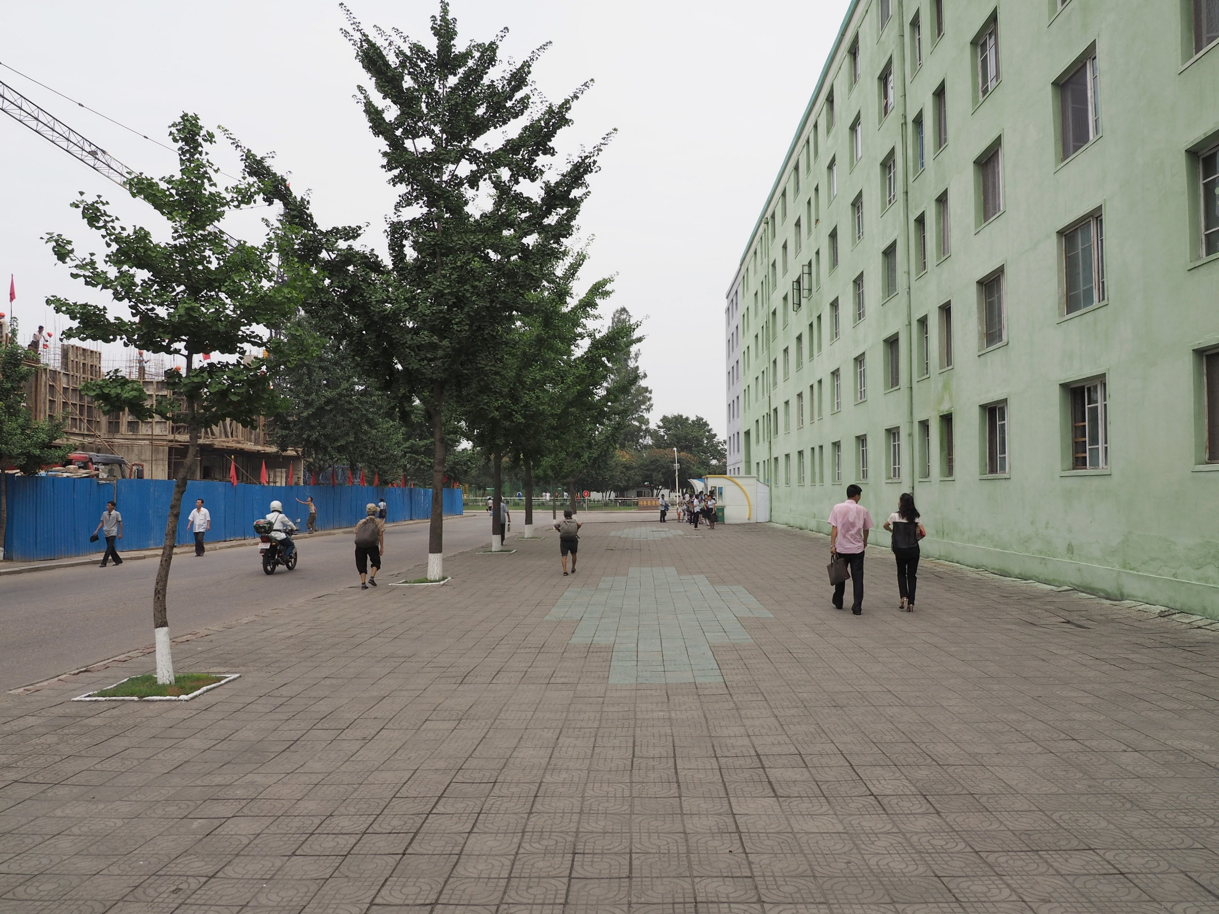 Streets of Pyongyang. Notice the clothing difference.