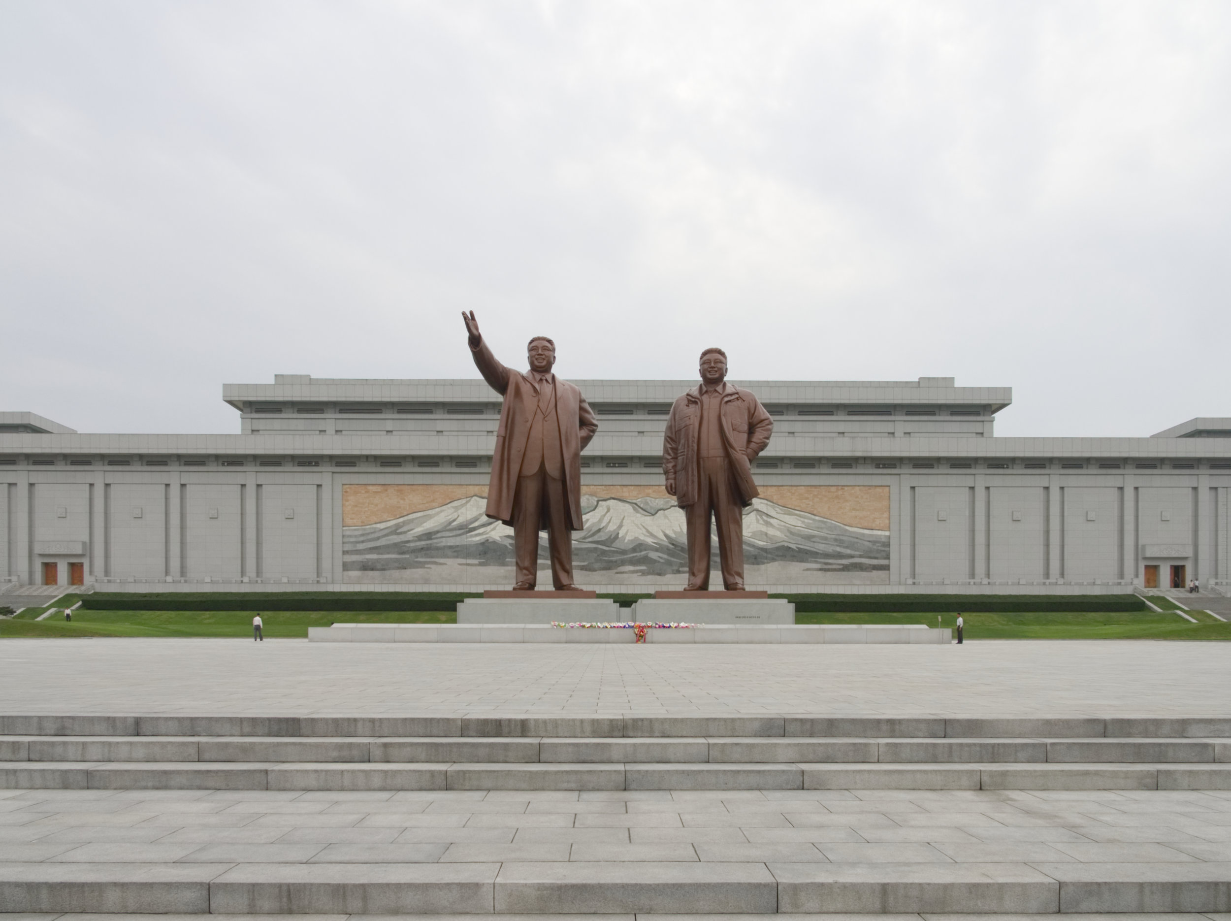 Flowers for the great leaders at the Mansudae Grand Monument