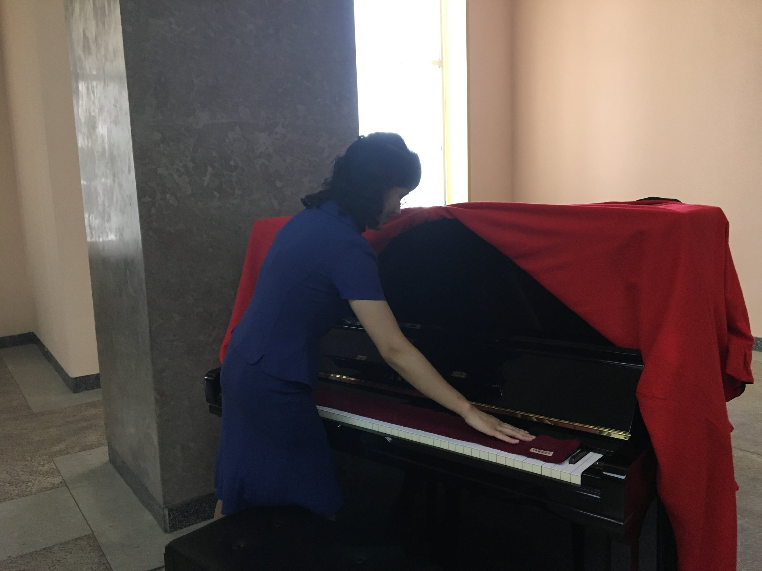 A Yamaha piano inside the library that I played on for a minute