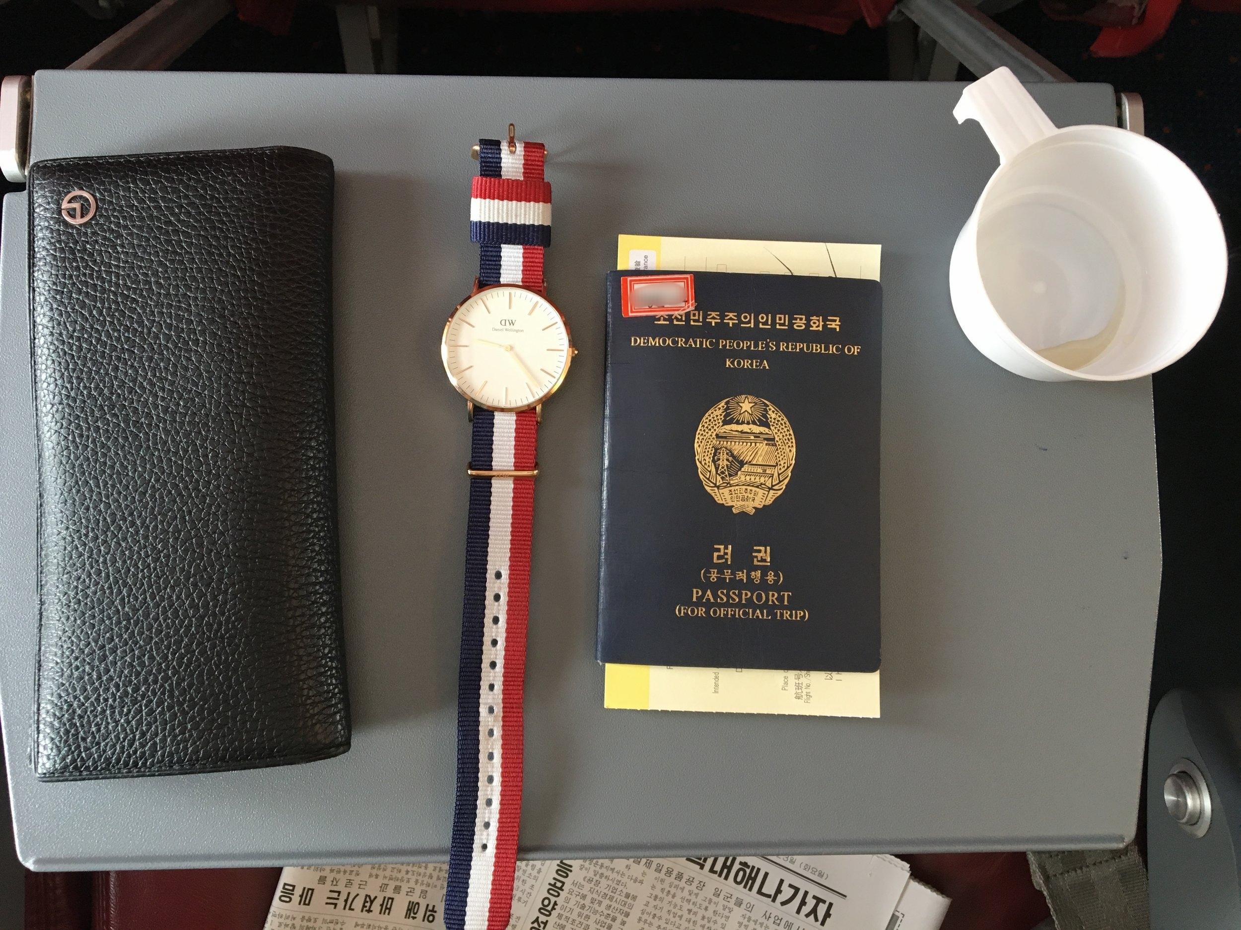 A North Korean student's Daniel Wellington watch and passport