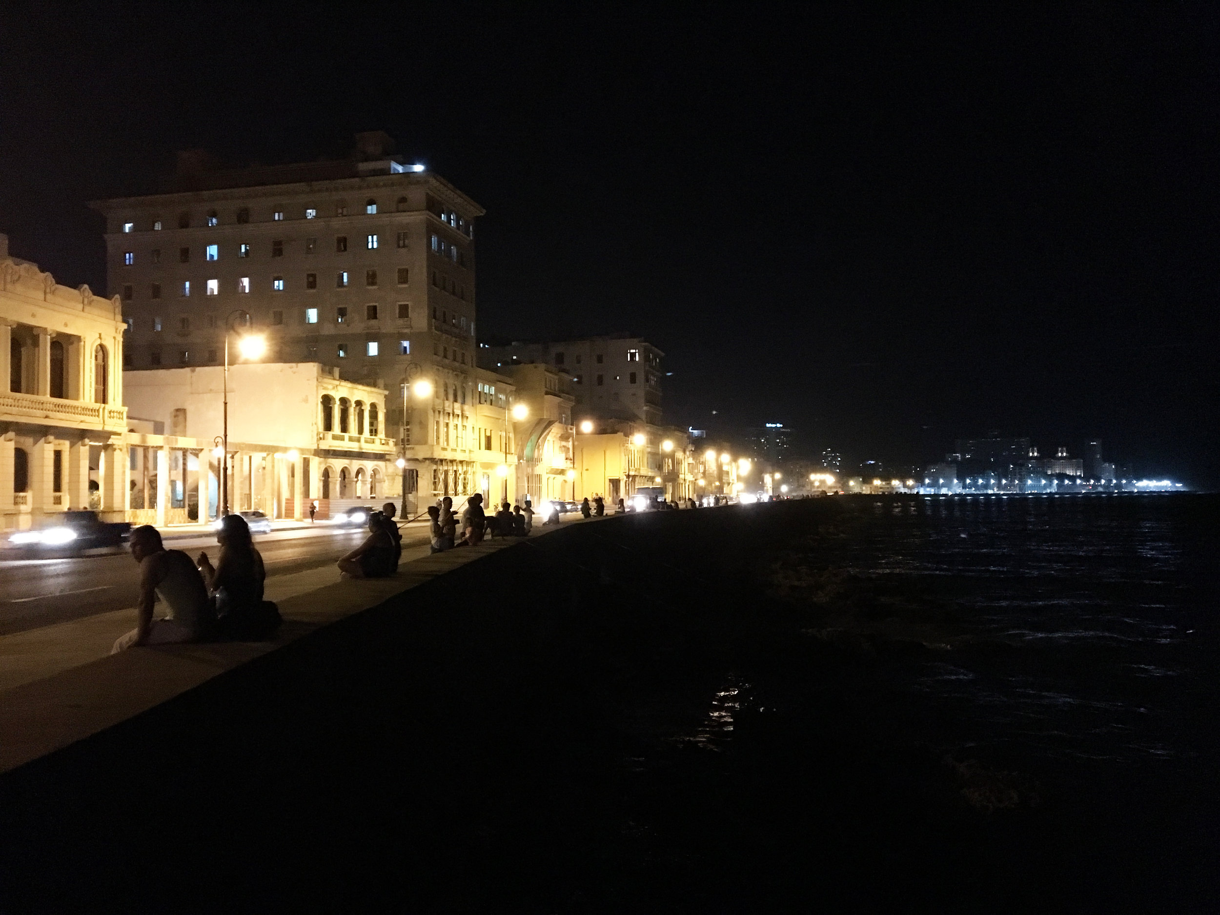 People hanging out on the Malecon in Havana at night