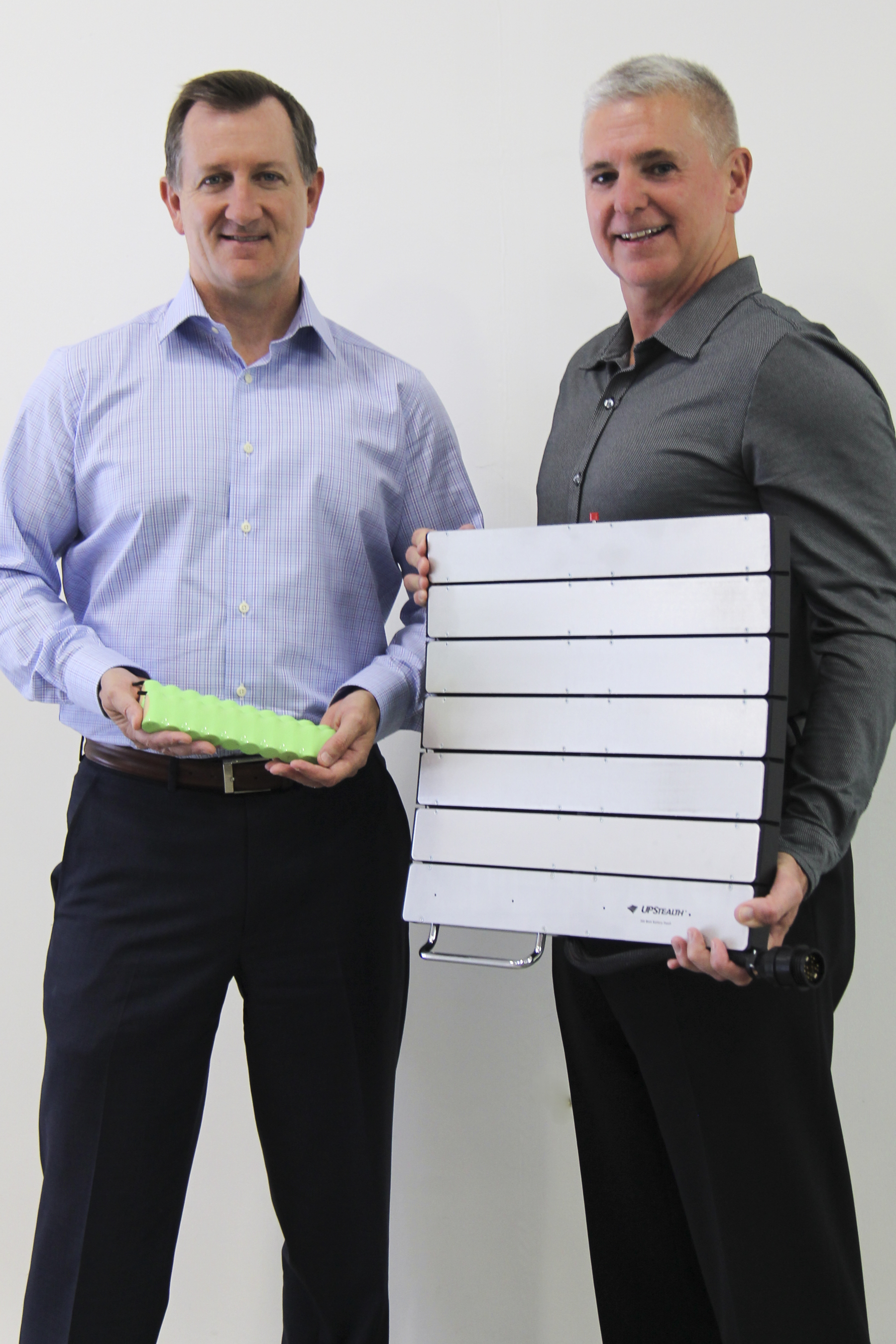 ZincFive's Tod Higinbotham & Tim Hysell with the patented nickel-zinc cells and UPStealth Battery Backup System