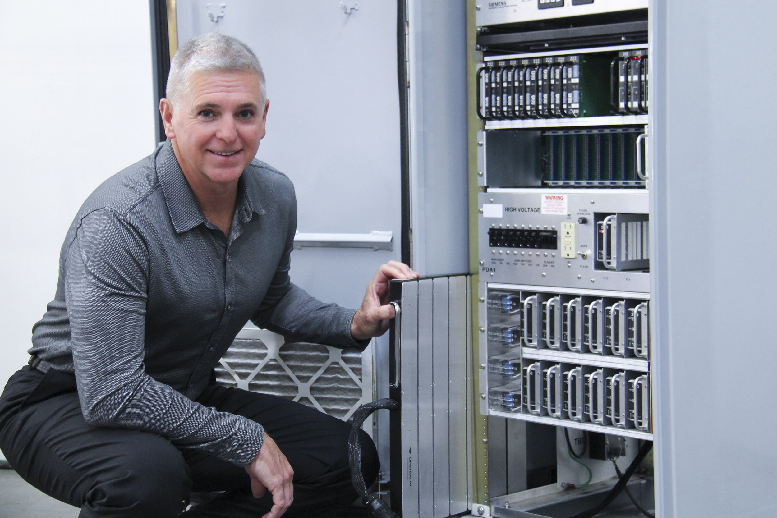 ZincFive CEO/Co-founder Tim Hysell and the UPStealth Uninterruptible Power Supply.