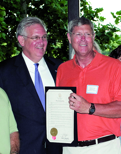 Tom Lovell 05 with Governor Nixon_June 2011.jpg