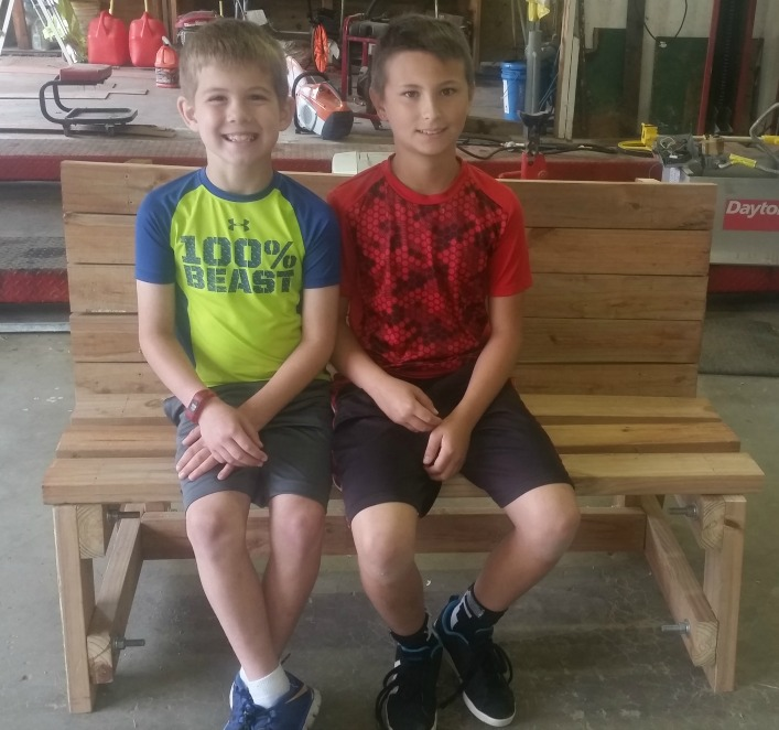 Maddox Hillmer (left) and Skylar Diehl try out the new bench.