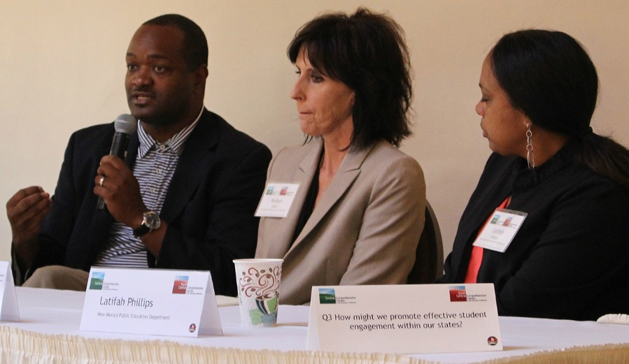 Dr. Dennis Carpenter (left) is pictured with panelists Robyn Miller (center) of the Oklahoma State Department of Education and Latifah Phillips (right) of the New Mexico Public Education Department.