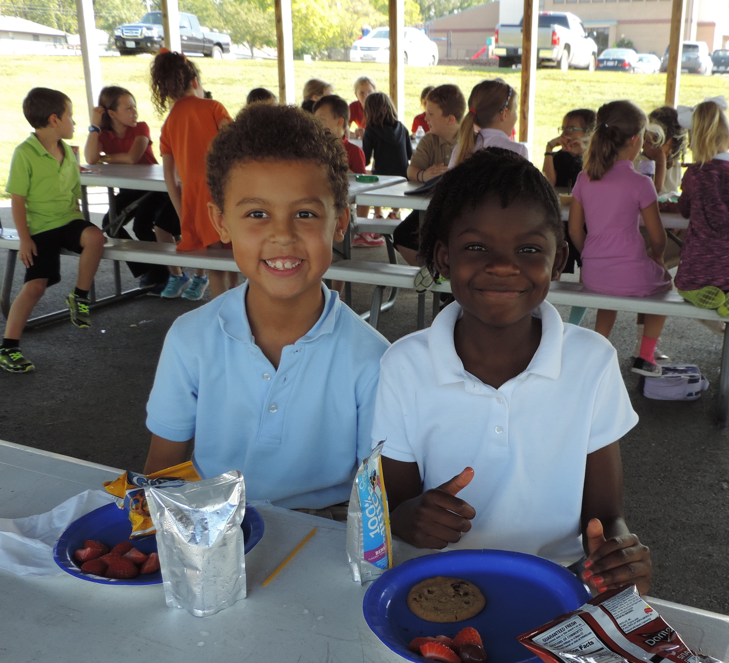"""SCA second graders Elijah Zicari and Londyn Foster, two of SCA's 56 """"Reader Leaders"""", were recently celebrated at an outdoor luncheon."""