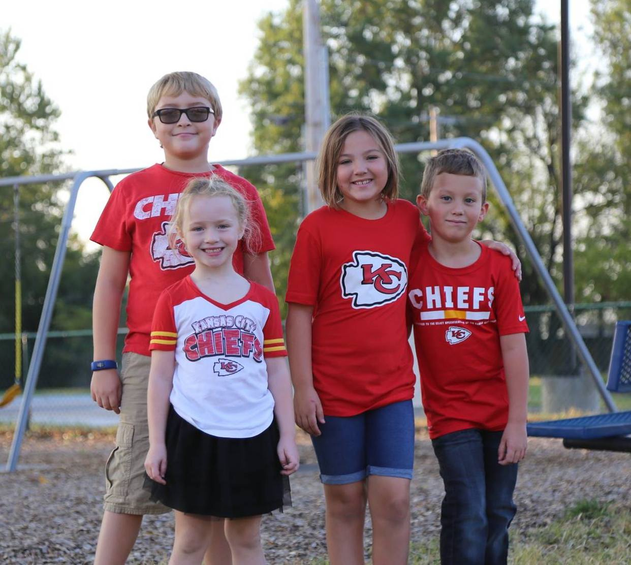 SCA elementary students Logan and Mallory Moenig with Addi and Myles Jeffries get excited to cheer on the Kansas City Chiefs on Red Friday on the campus of Summit Christian Academy.