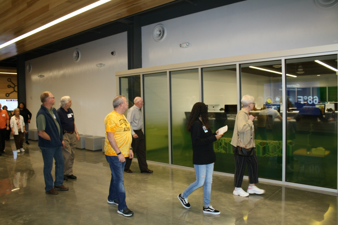 Senior citizens tour the Missouri Innovation Campus, guided by student ambassadors and staff members.