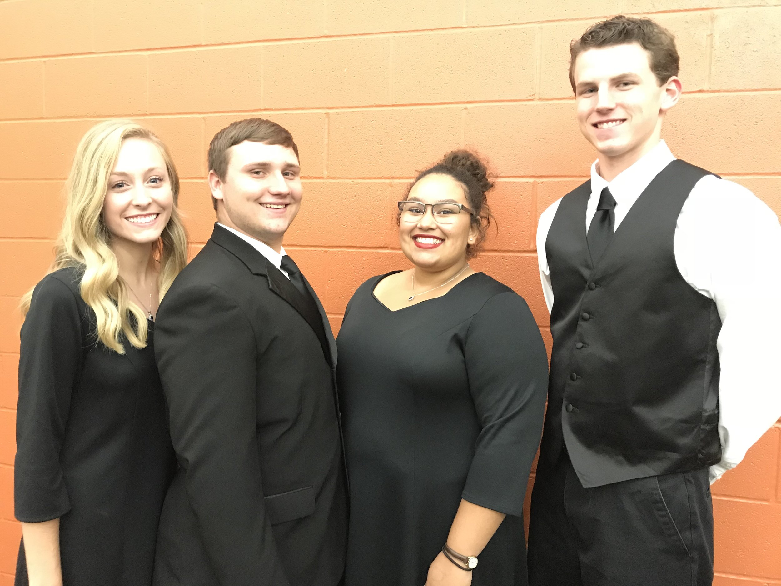 Pictured here SCA Seniors Emilie Moyer (left) and Alley Brown (right) were selected for the KC Metro Women's Honor Choir along with Senior Michael Werner (left) and Patrick Simpson (far right) who were selected for the KC Metro Men's Choir.