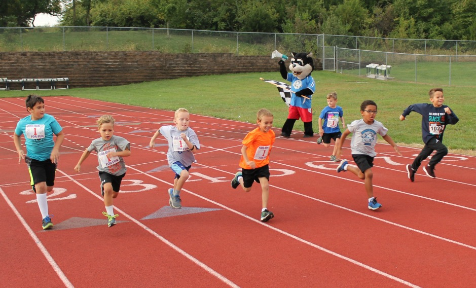 Runners, walkers and children participate in Race for the Future and the event's Kid's Dash.