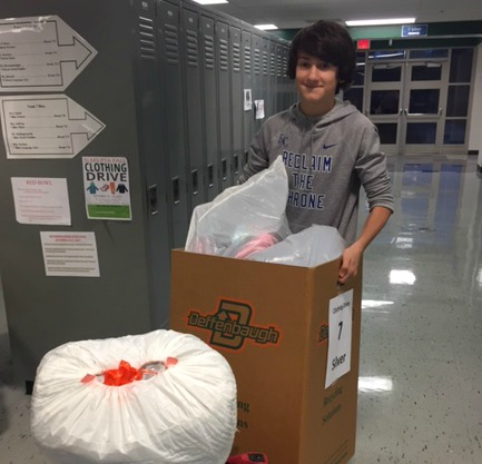 Nick Harris helps collect clothing during the drive.