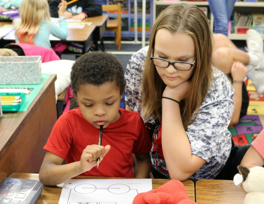 LSNHS student Katelyn Esry works with a first grader at Westview Elementary.