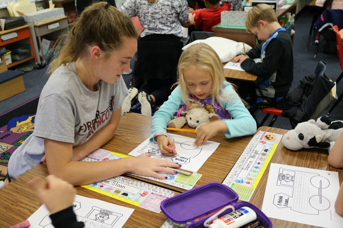 LSNHS student Regan Young works with a first grader at Westview Elementary.