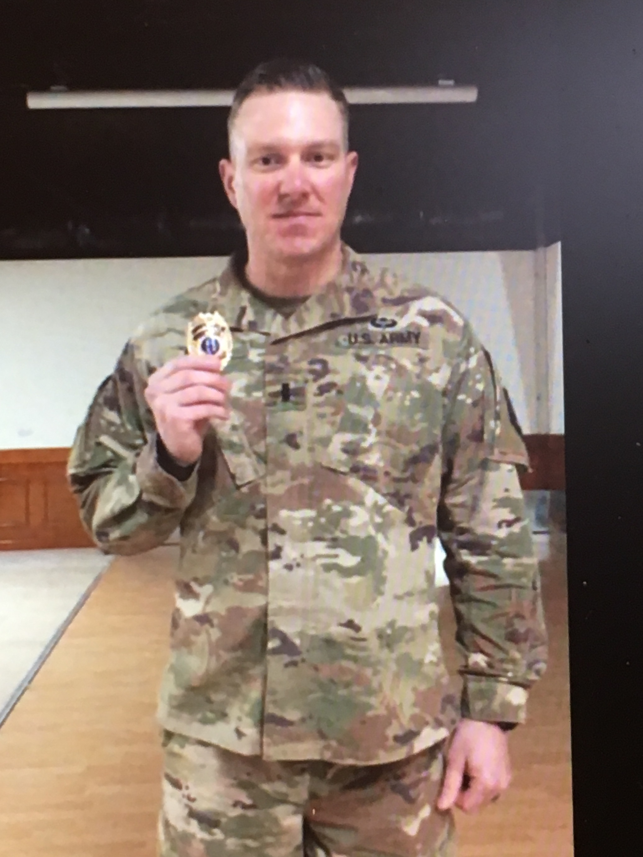 Captain Ben Hicks with his new badge in Qatar.