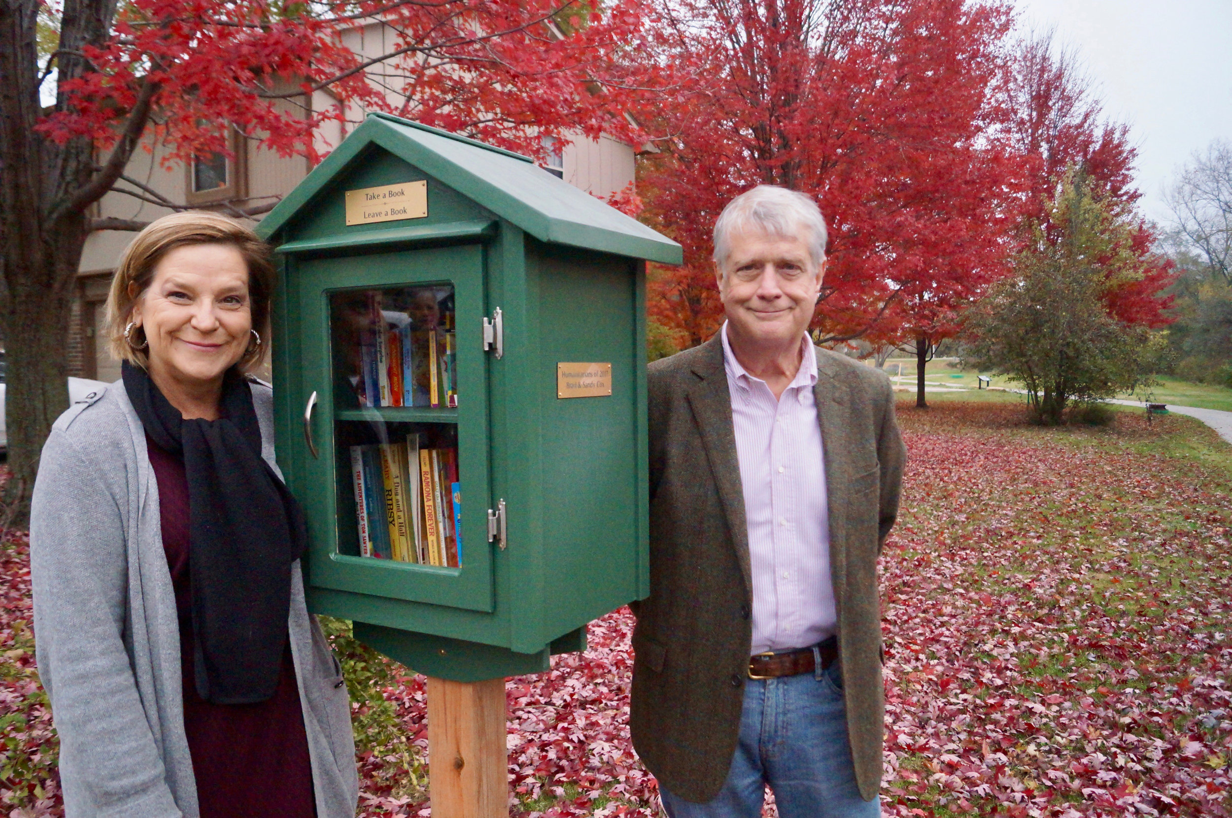 Courtesy Amy Valmassei  | Sandy and Brad Cox helped the Lee's Summit Parks & Recreation department celebrate the opening of a new Little Free Library at Langsford Park.