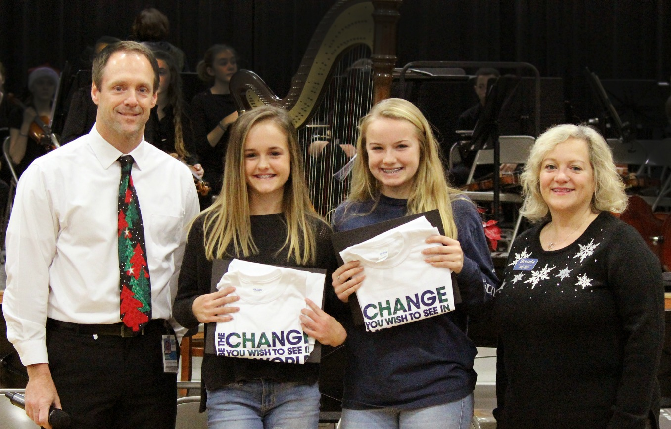 Pictured are (from left) David Mitchell, SLMS principal; Jadyn Steele; Molly Bruno; and Brenda Madaris of Arvest Bank.