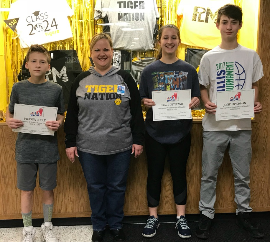 Winners are (from left) Joseph Bachman, Most Improved Eighth-grader; Grace Distefano, Outstanding Eighth-grader; Ava Roca, Most Improved Seventh-grader (not pictured); and Jackson Goold, Outstanding Seventh-grader. Dr. Janette Miller (center), PLMS principal, presented the students with their awards.