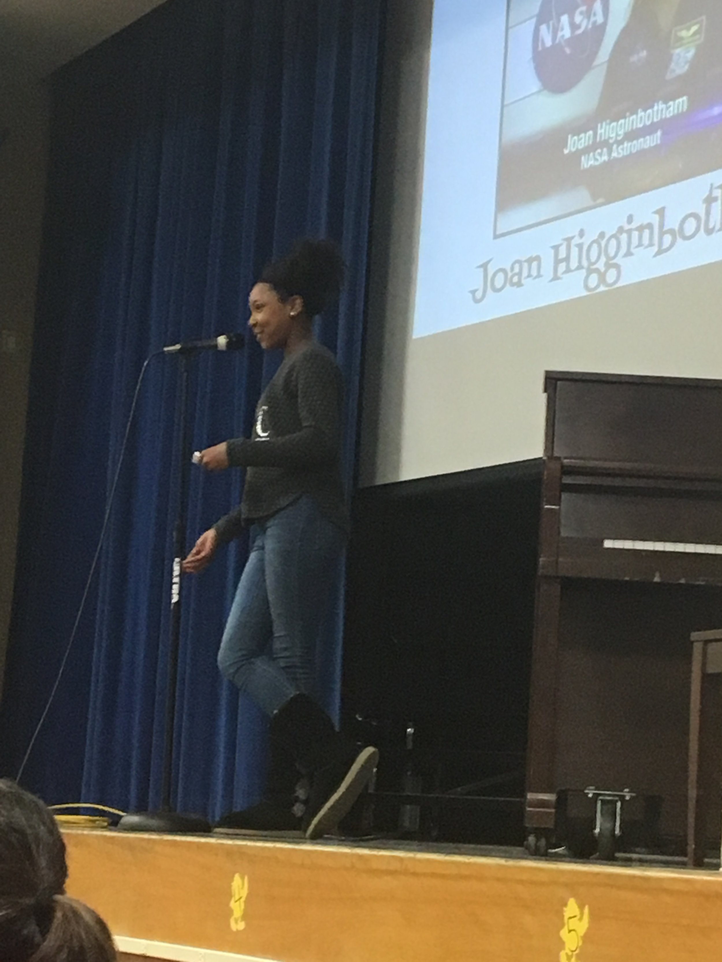 Mia Meyer recognizes Joan Higginbotham during the assembly.