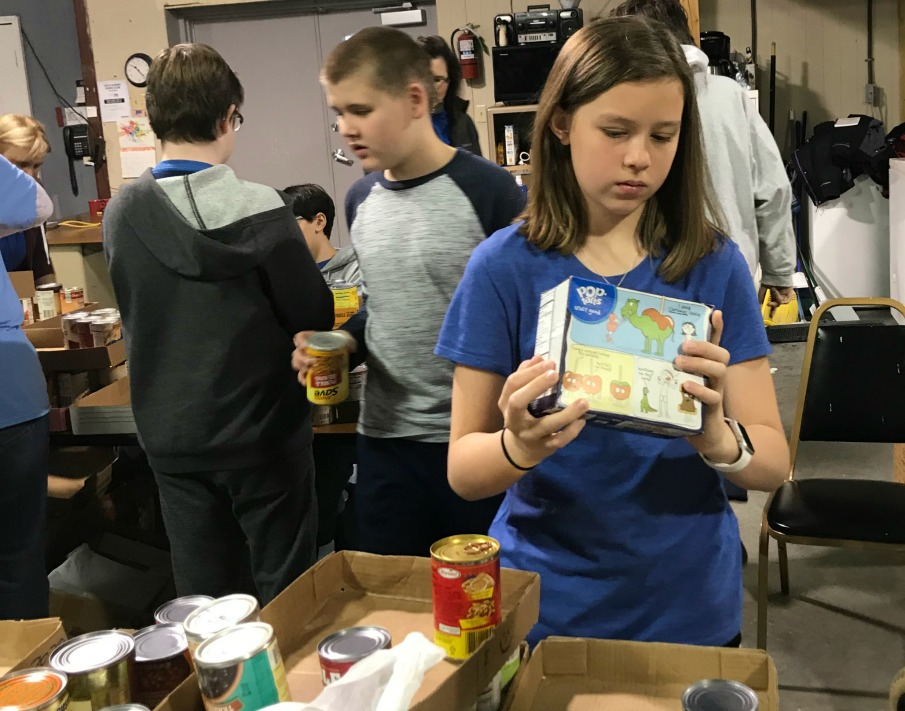 Students help sort donated food at Lee's Summit Social Services.