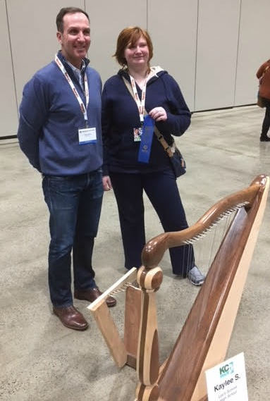 Kaylee Smith won first place in home accessories for this harp. Also pictured is KC MADE Chair Drake Vidrine.