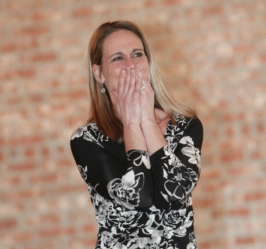 Anne Braun reacts as she is named Teacher of the Year.