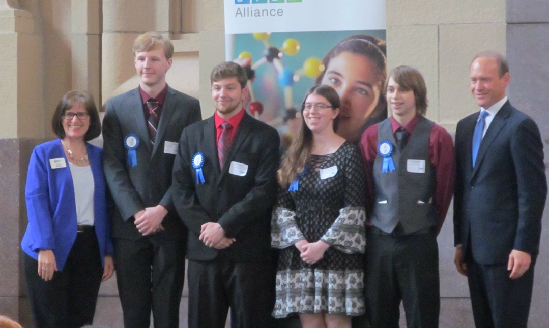 First-place awardees are in the engineering category, project title: The Omni-directional Wheelchair, are (from left) Martha McCabe, KCSTEM Alliance executive director; Trey Weeda; Tyler Wascom; Amanda Hill; Levi Madden; and Dr. Vince Bertram, Project Lead The Way CEO.