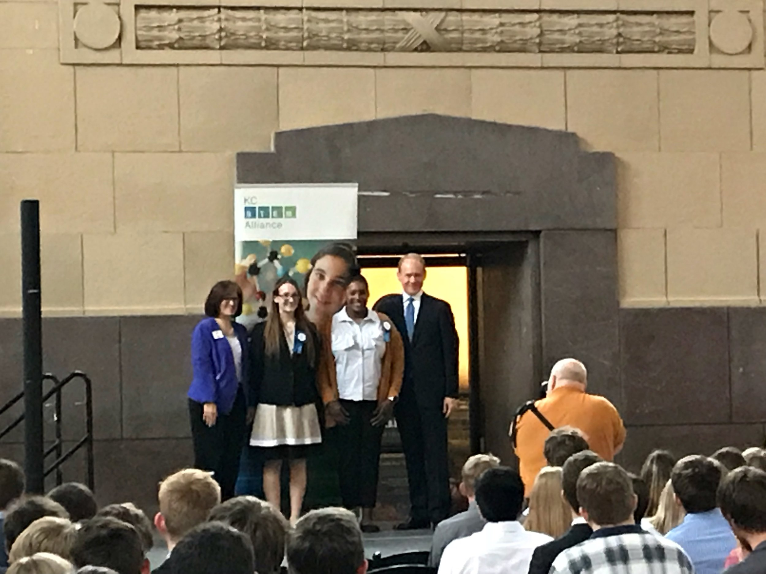 First-place winners in the biomedical category, research title: Cell Phone Emissions Effect on the Growth and Development of C. Elegans, are (from left) Martha McCabe, KCSTEM Alliance executive director; Mikayla Odell; Jayci Goodwin; and Vince Bertram, Project Lead The Way CEO.