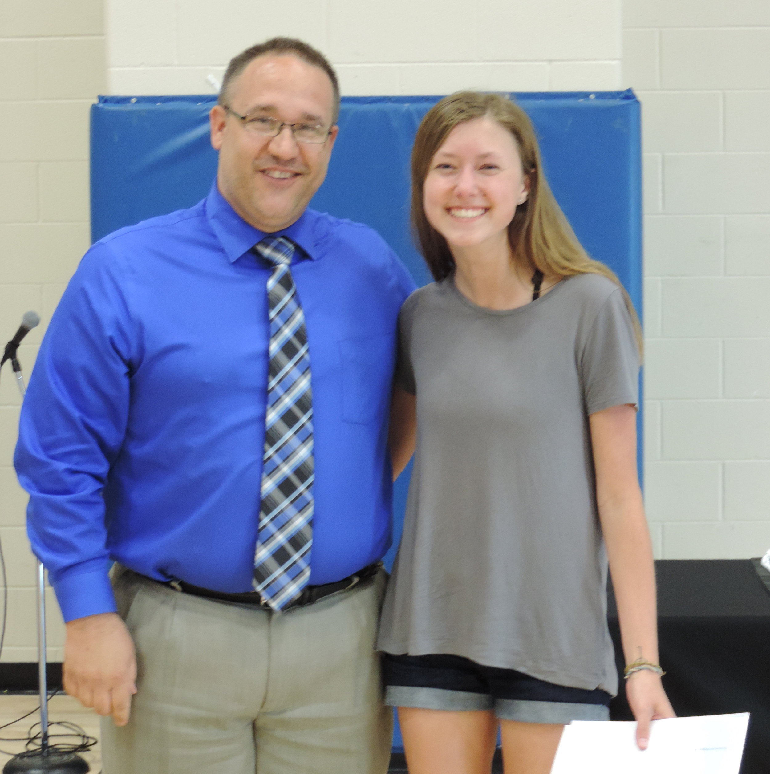 - SCA Senior Reagan Lyle, pictured with Secondary Principal and Operations Director Joe Hesman, was recently named as SCA's Secondary Christian Character Student of the Year.