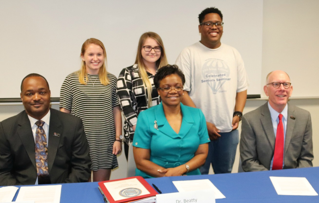 Pictured following the ceremonial signing are (front row, from left) Dr. Carpenter, Dr. Beatty, Dr. Ambrose, (back row, from left) Cassidy Robinson, Rylie Anderson and Isaiah McDaniel.