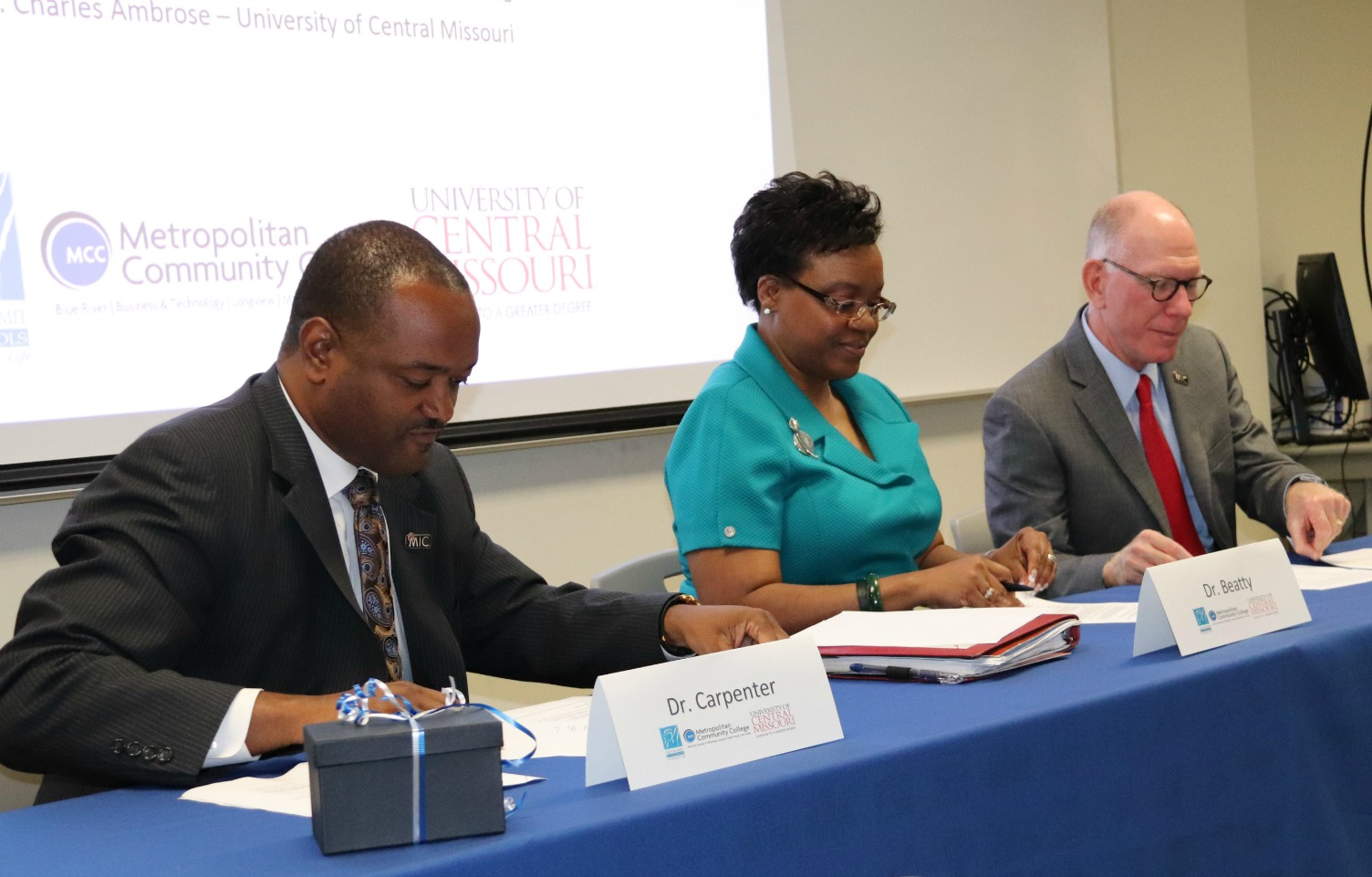 Signing the memorandum of understanding are (from left) Dr. Carpenter, Dr. Beatty and Dr. Ambrose.