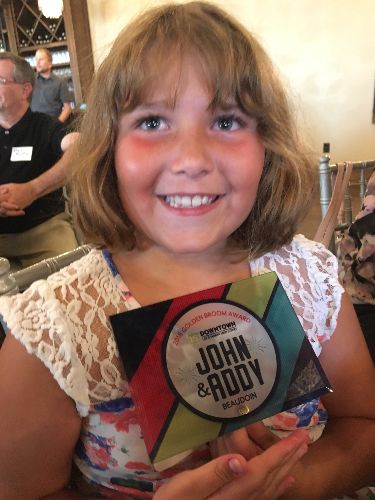 Addy Beaudoin and her father, John, were awarded the 2018 Golden Broom Award at last month's Downtown Lee's Summit Main Street annual banquet. The award recognized their volunteer service to the community, specifically a clean-up event organized prior to the Big Bash celebration which drew visitors from across the nation.