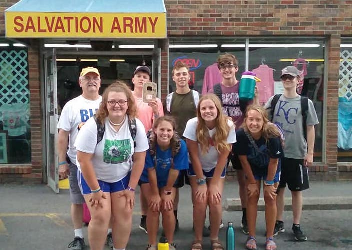 SCA seniors cleaned and organized at Salvation Army's thrift store and office.
