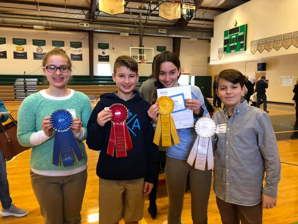 Four SCA students qualified to compete in the Regional ACSI Spelling Bee in Plano, TX in March. Those students include (left to right): 8th grade student Olivia Truesdale, 6th grade student Michael Ward, 6th grade student Lucie Epema, and 7th grade student Adrian Haack.