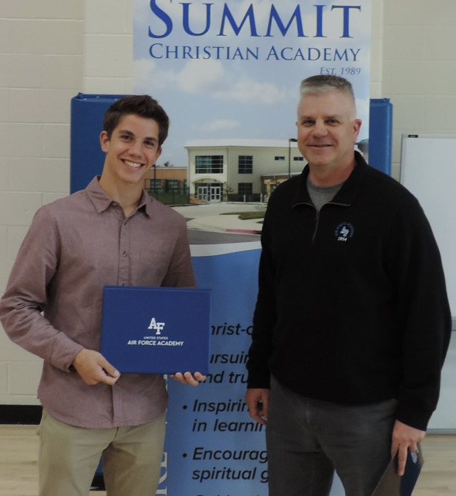 SCA Senior Josh McConnell, pictured with Colonel Stane Cole, was appointed and accepted his appointment to the United States Air Force Academy. ( Photo courtesy Summit Christian Academy )