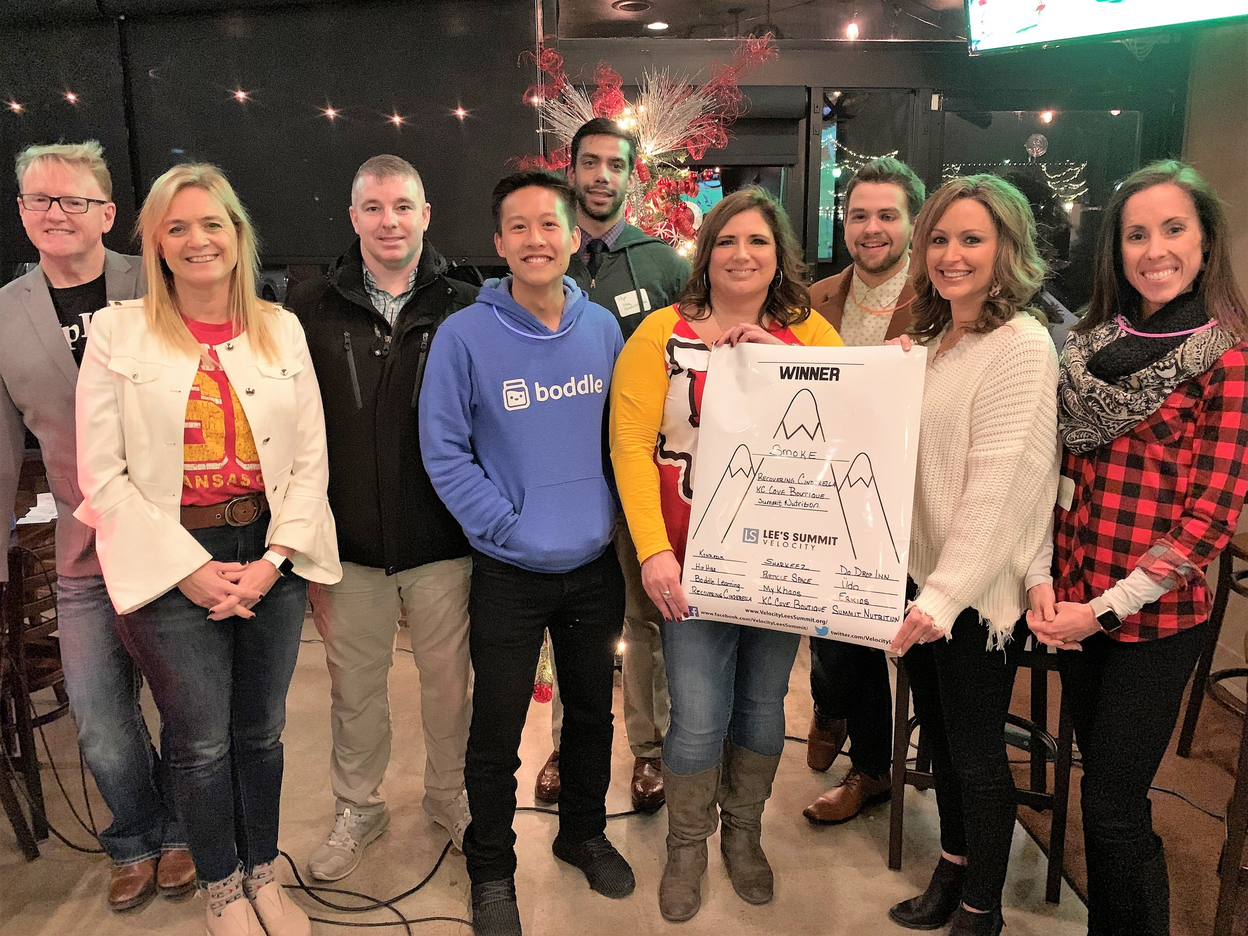 Nine business owners pitched the ideas at the December 2018 Velocity LS event. Keri Olson, fourth from right, owner of Recovering Cinderella, was crowned the winner at the final stop, Smoke Brewing Company. ( Photo courtesy John Beaudoin )