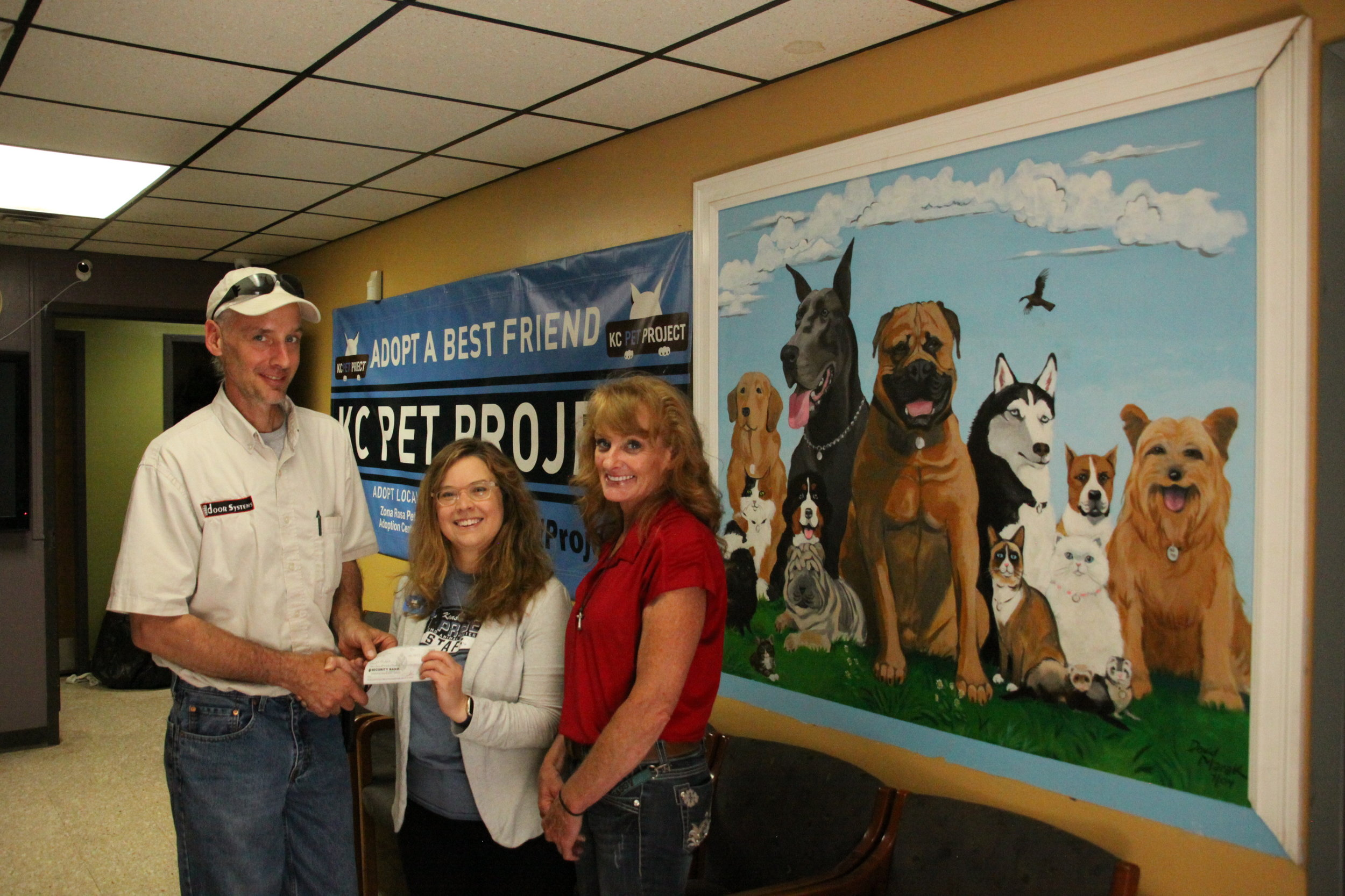 KC Pet Project - Door Systems Have a Heart Donation.JPG